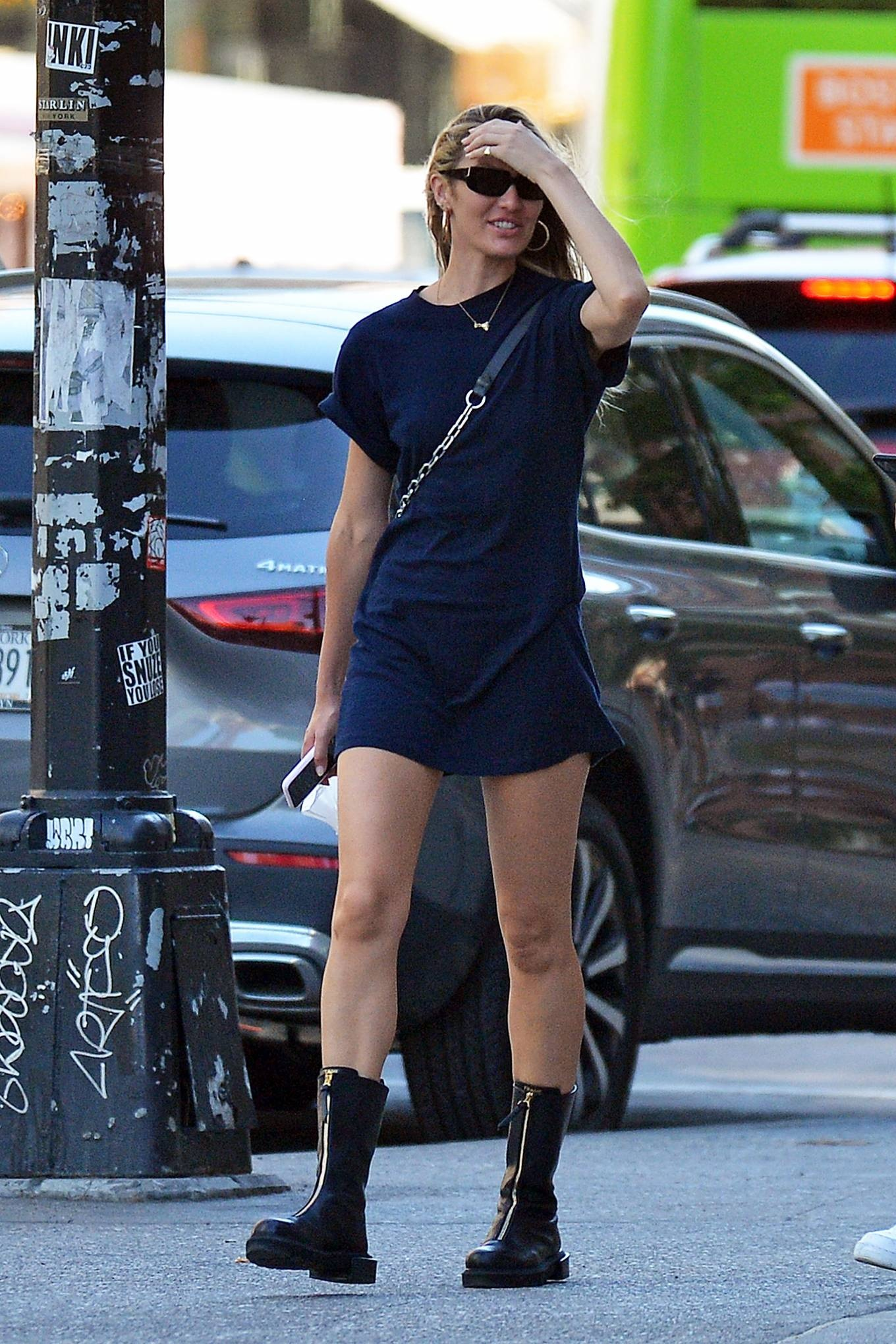 Candice Swanepoel rocking zipper accents black leather knee high boots with cuban heel