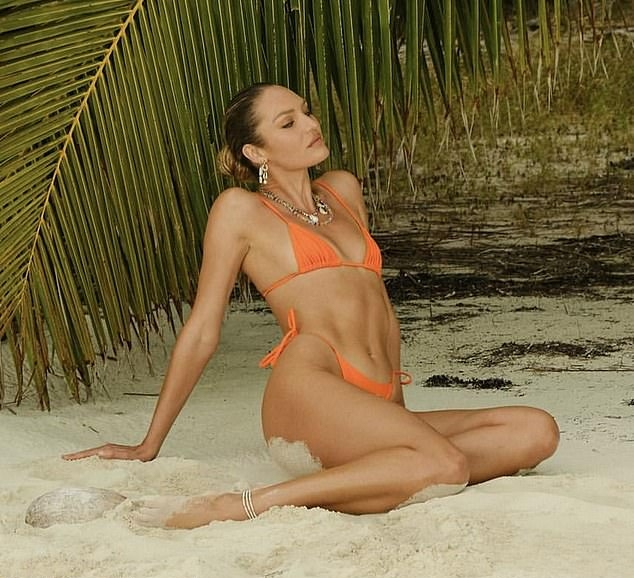 Candice Swanepoel, Tropic Of C bikini top, orange bikini top, orange Tropic Of C bikini bottom, enviable decolletage, tiny, spaghetti straps, tie back, skimpy, make the most, sexy, very low neck, abs. Candice Swanepoel donning a plunging orange bikini top with tie back and spaghetti straps