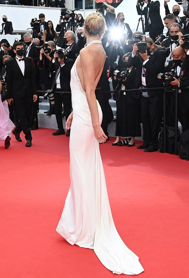 Candice Swanepoel donning pointed white sandals