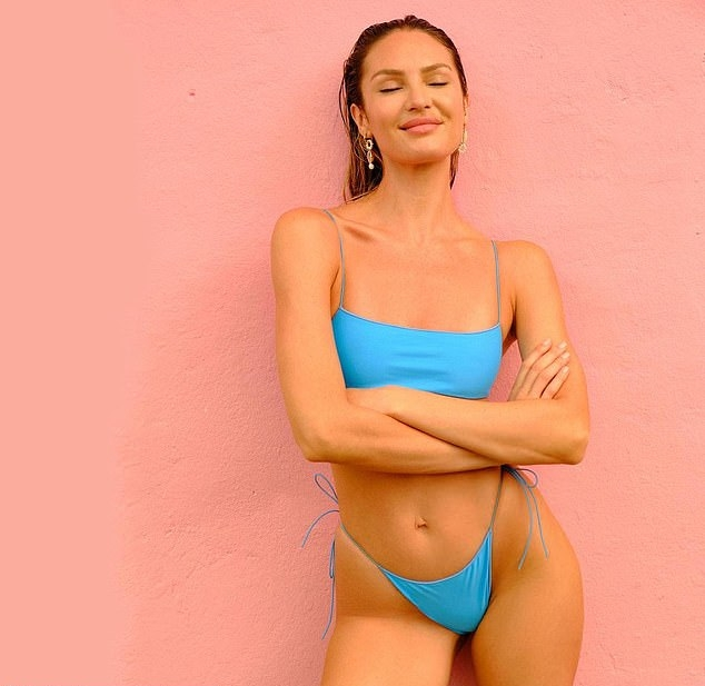 Candice Swanepoel wearing sexy blue summery bikini bottom with low rise with tied waist