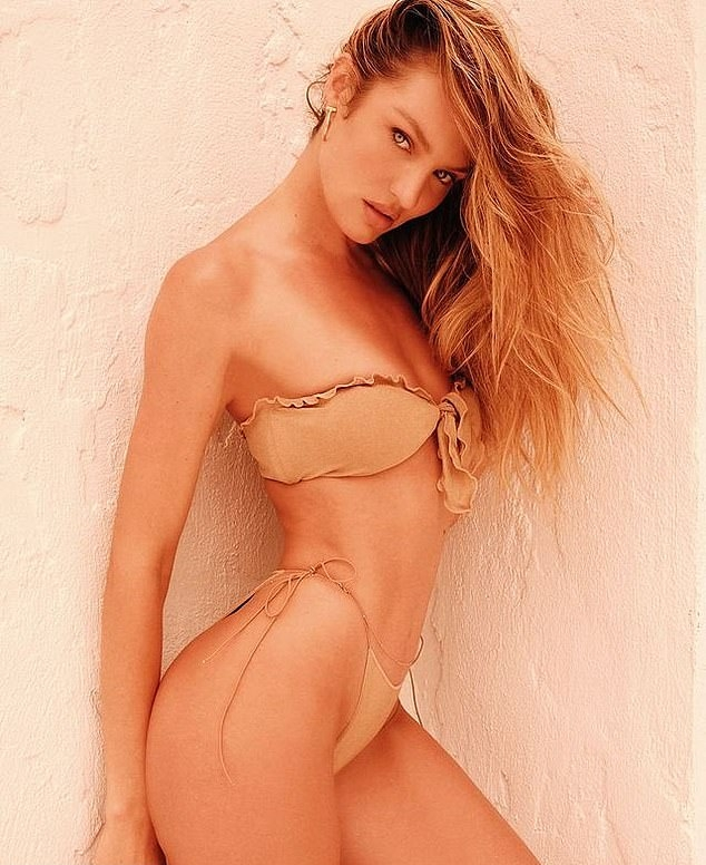 Candice Swanepoel, Tropic Of C bandeau, nude bandeau, nylon, show off, ruffled, spandex, tiny, skimpy, Tropic Of C bikini top, beige bandeau, model figure, sexy, nude bikini top, bikini body, front tied, beige bikini top. Candice Swanepoel rocking a skimpy nude bandeau with a nylon material and ruffled