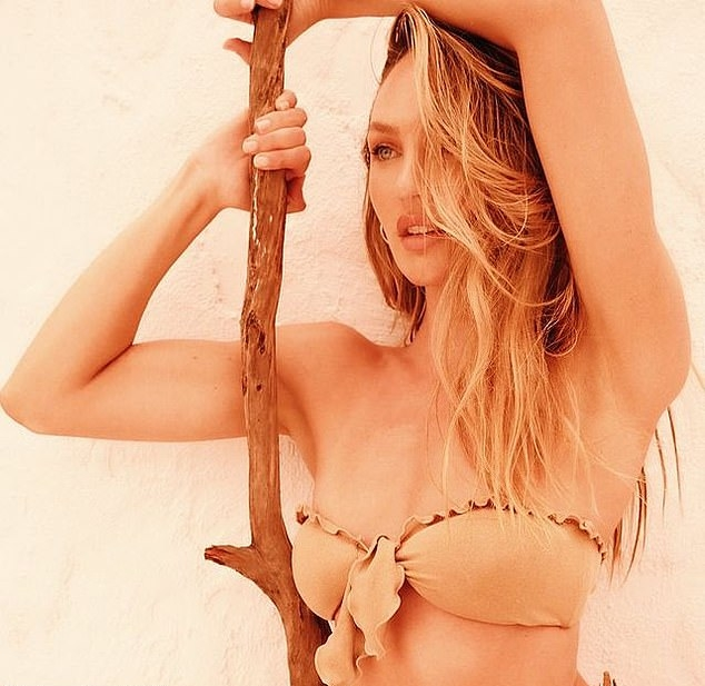 Candice Swanepoel rocking a skimpy nude bandeau with a nylon material and ruffled