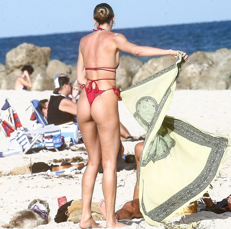 Candice Swanepoel wearing a red nylon bikini top with tie back