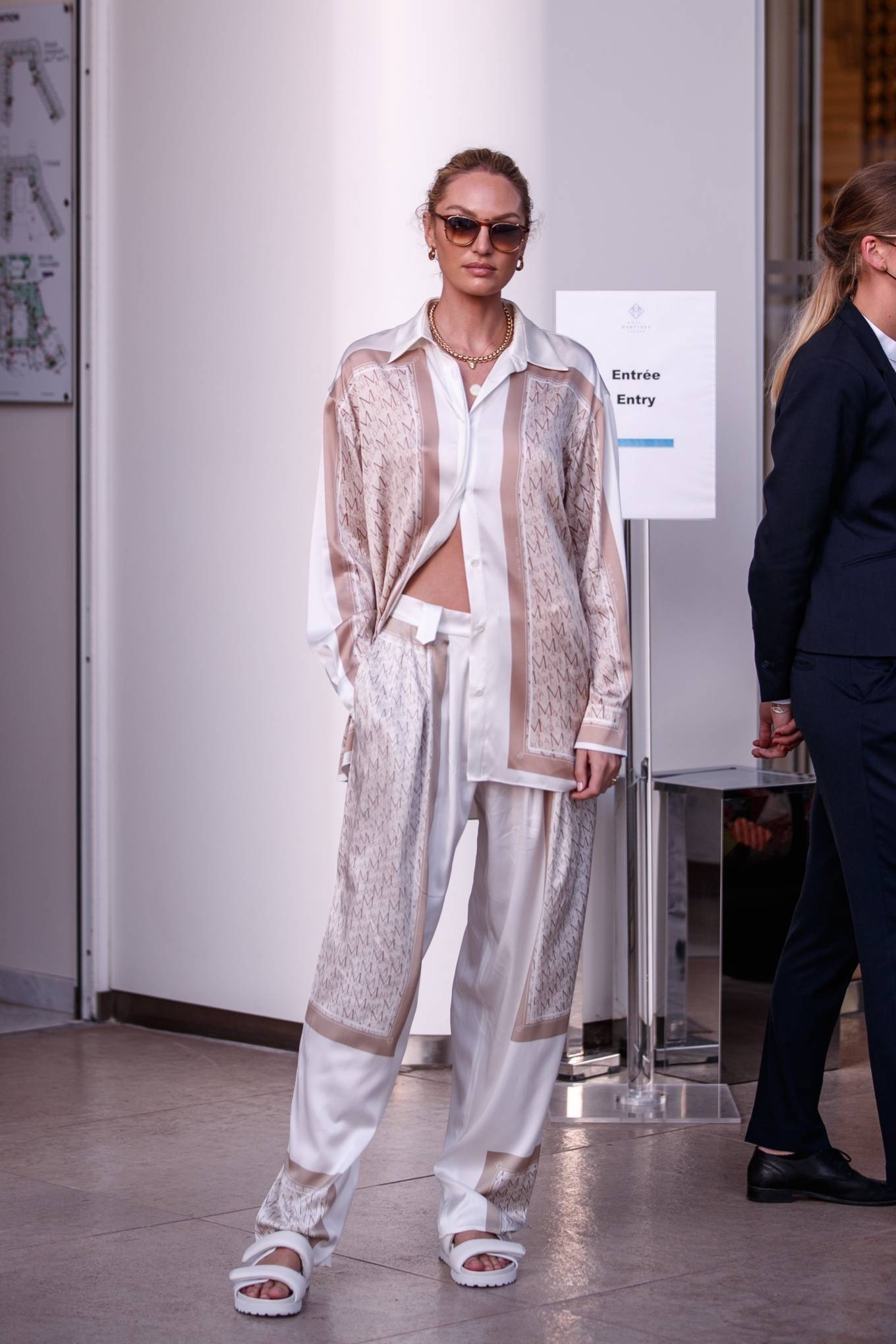 Candice Swanepoel donning round white two-strap sandals with chunky sole