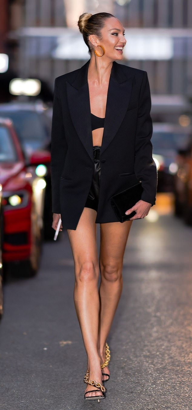 Candice Swanepoel donning chain detailing black patent-leather ankle sandals by Giuseppe Zanotti