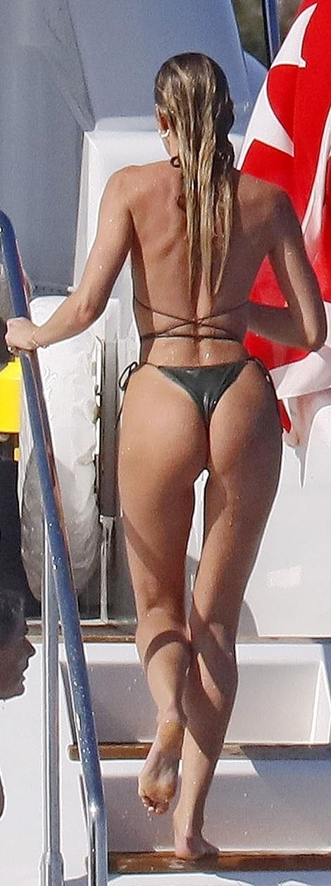 Candice Swanepoel donning a grey nylon bikini top with tie back