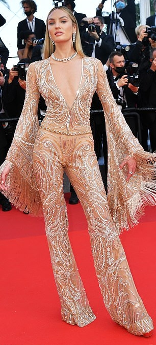 Candice Swanepoel donning a plunging nude jumpsuit with a sequin detailing fabric, flared sleeves, embellished and flared hem