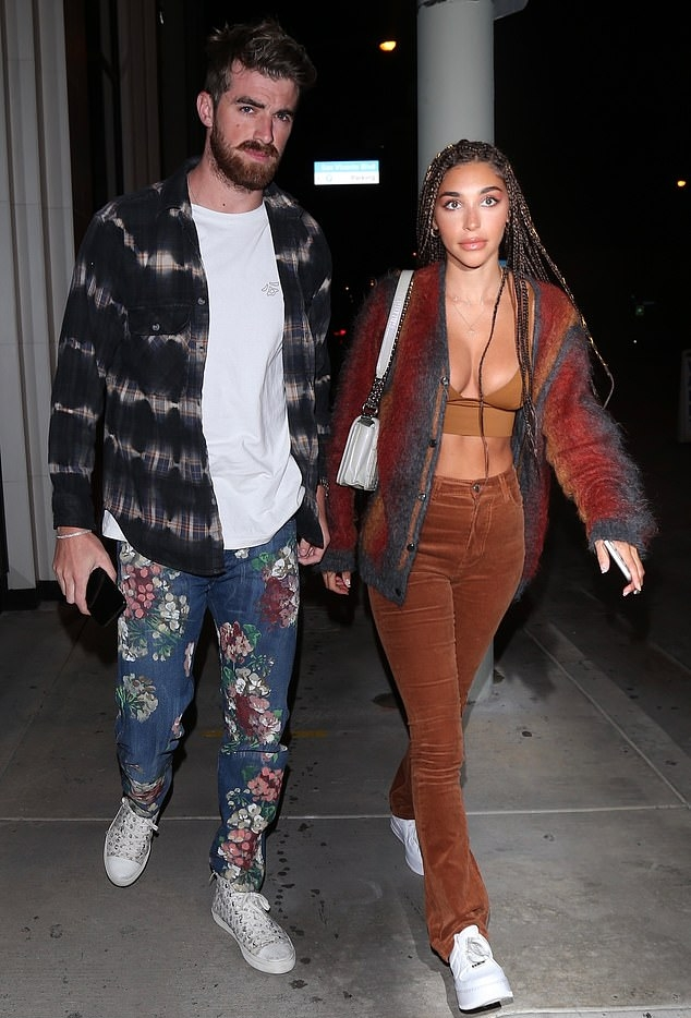 Chantel Jeffries wearing white lace-up sneakers