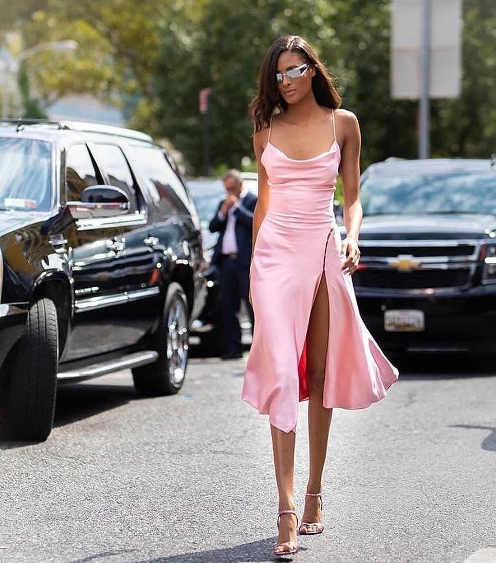 Cindy Bruna donning pink open toe sandals with high heel and thin straps