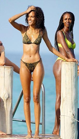 Cindy Bruna donning Skimpy green snake printed Solid and Striped bikini bottom