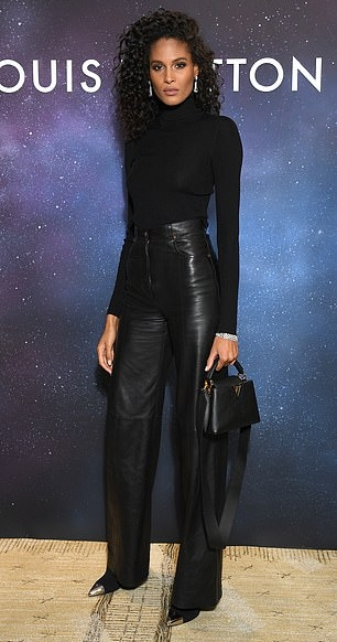 Cindy Bruna donning a figure hugging black bodysuit with full sleeves and a turtleneck