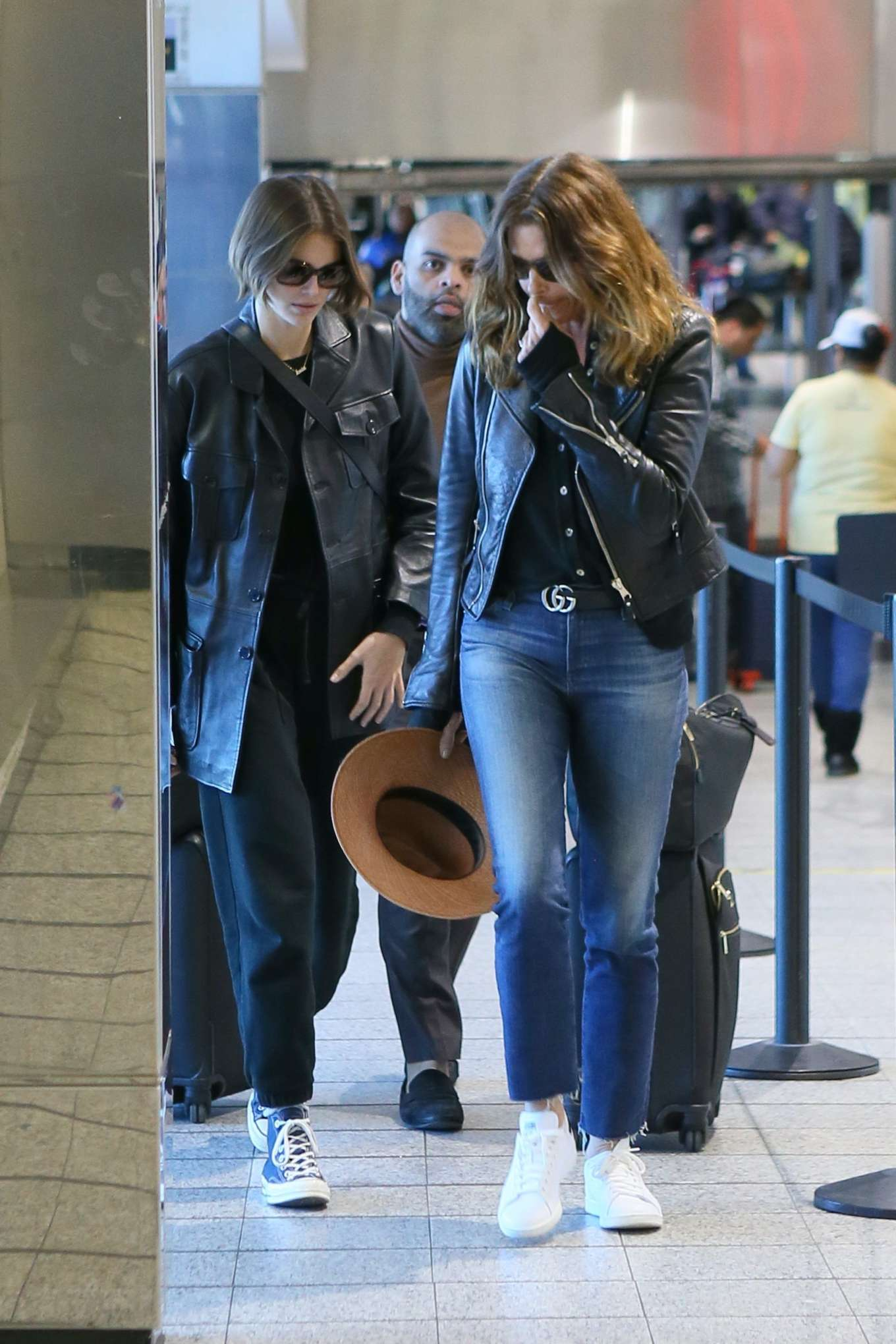 Cindy Crawford wearing white leather lace-up sneakers