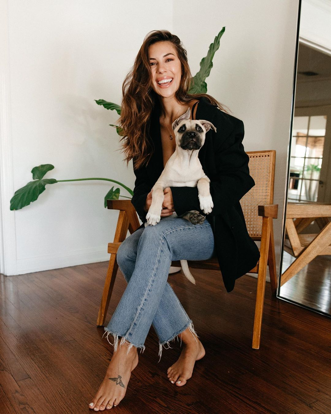 Devin Brugman rocking a casual black button front blazer with extra long sleeves and peak lapel collar