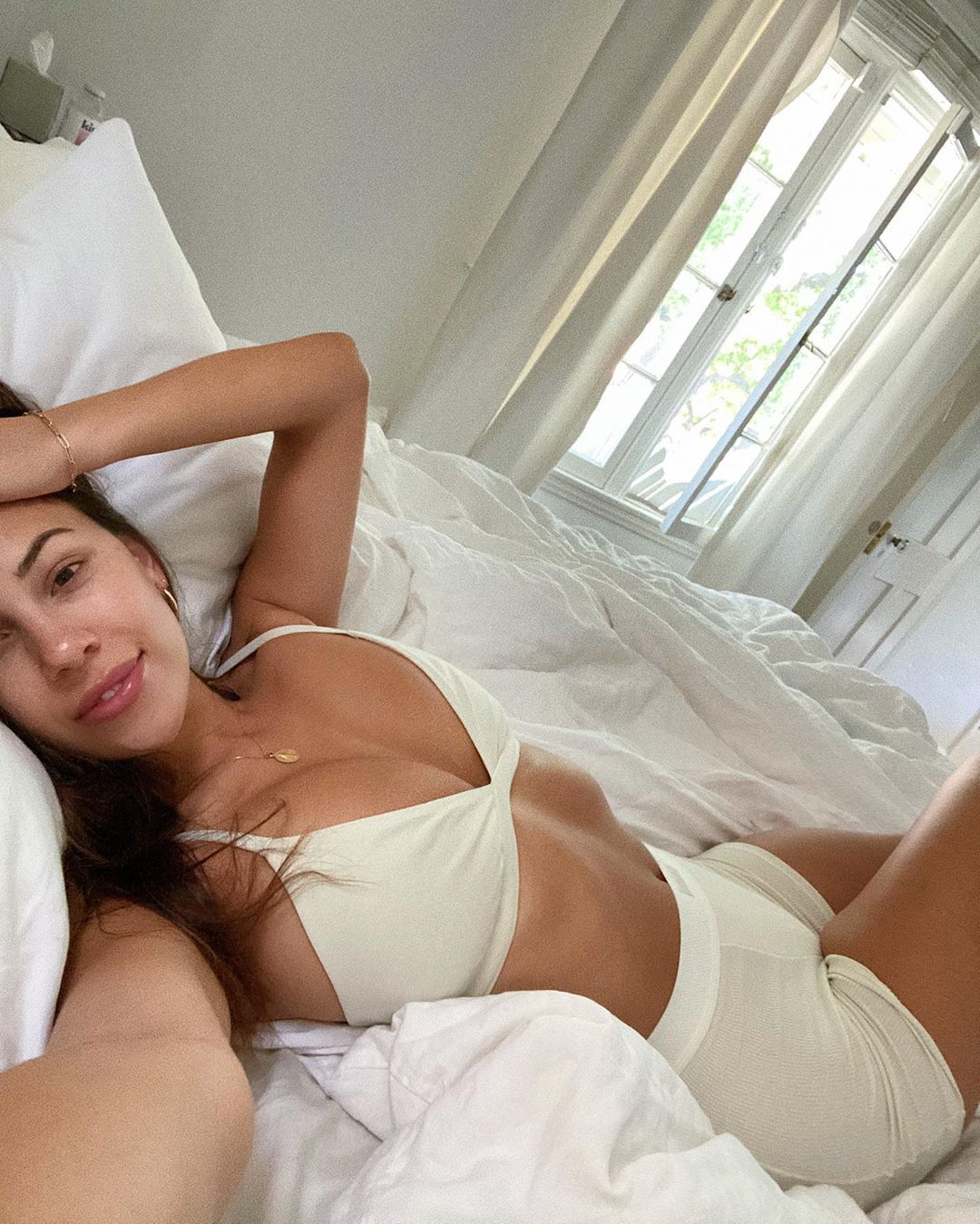 Devin Brugman rocking a Plunging ivory Skims bralette with a cotton material, thin shoulder strap and a V-neck