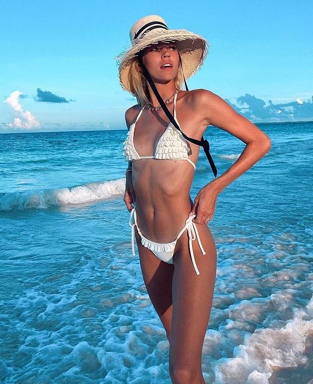 Devon Windsor donning Skimpy white ruffled Devon Windsor bikini bottom with ruffled