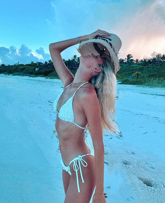 Devon Windsor donning Skimpy white ruffled Devon Windsor bikini bottom with ruffled