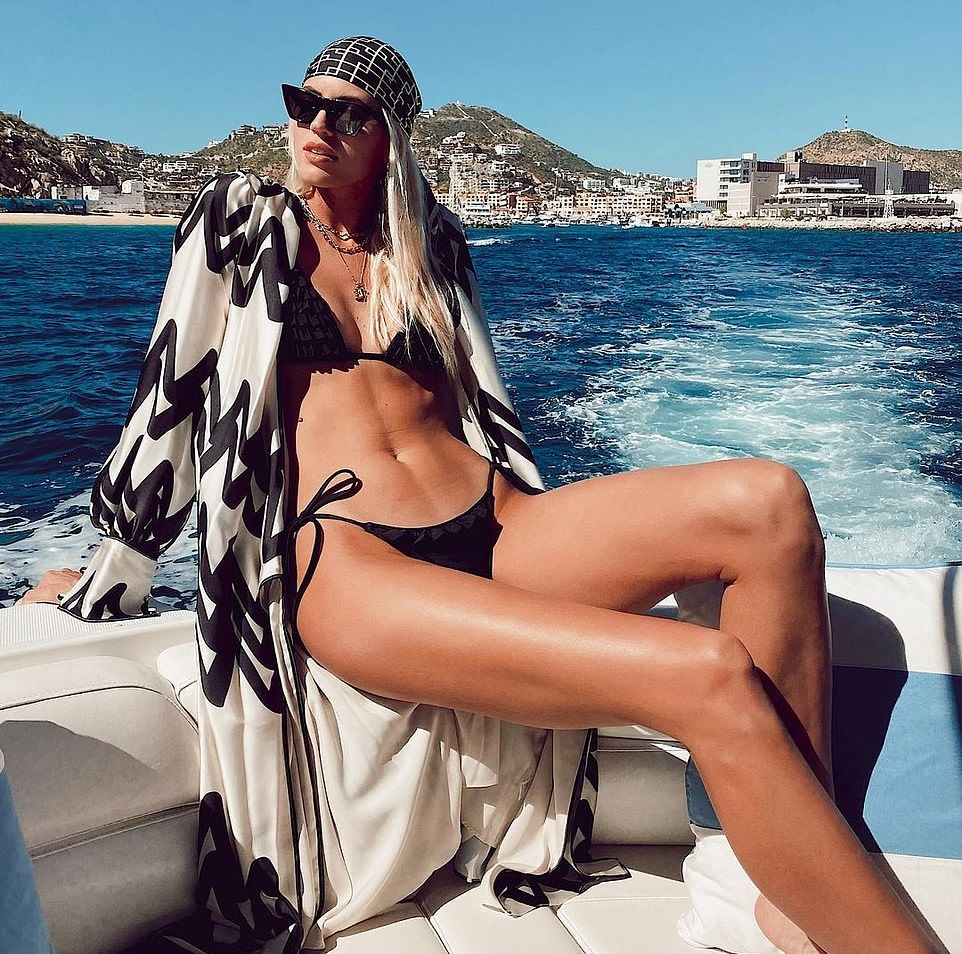 Devon Windsor donning Skimpy black ruffled bikini bottom with ruffled