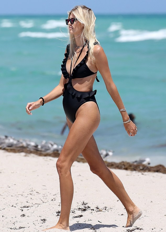 Devon Windsor donning a deep V-neck bodysuit with ruffled and straps