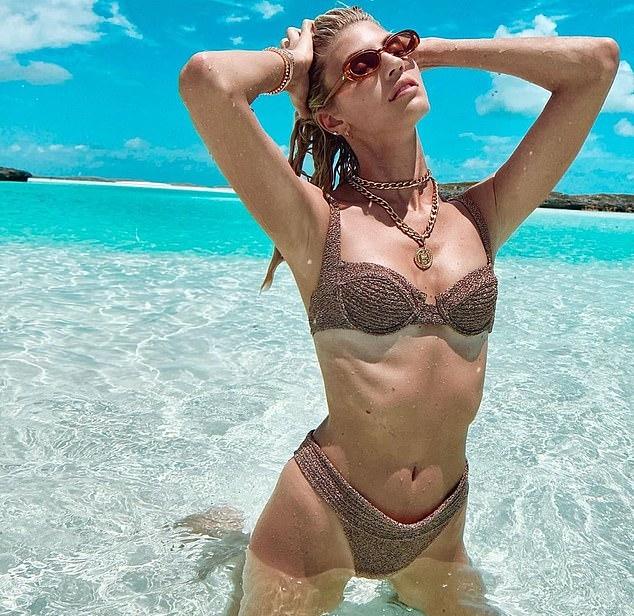 Devon Windsor donning Brown bikini bottom