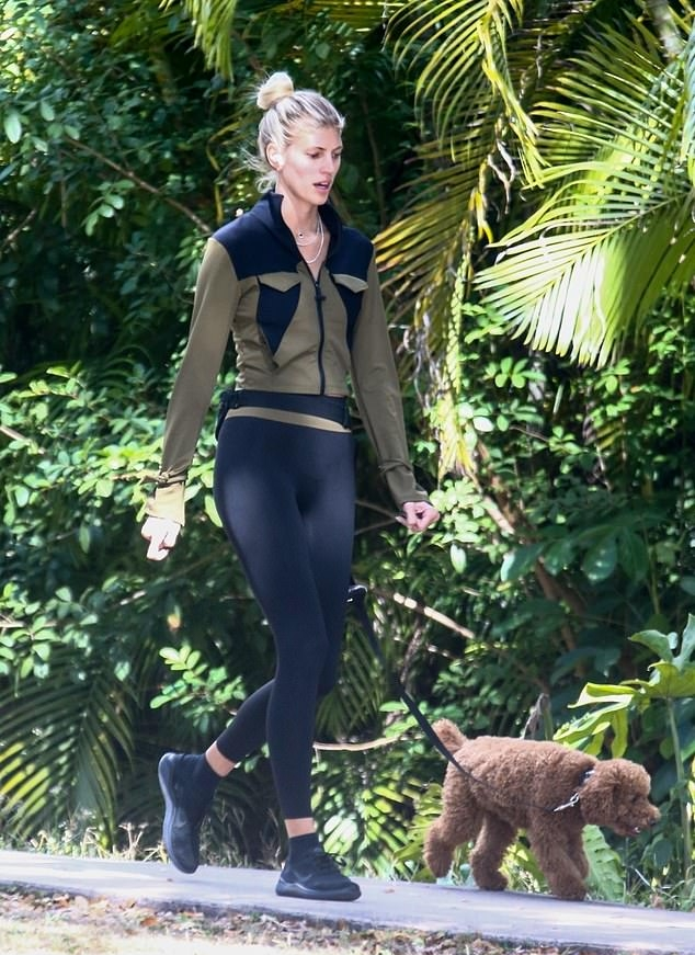Devon Windsor donning round black lace-up sneakers with flat heel