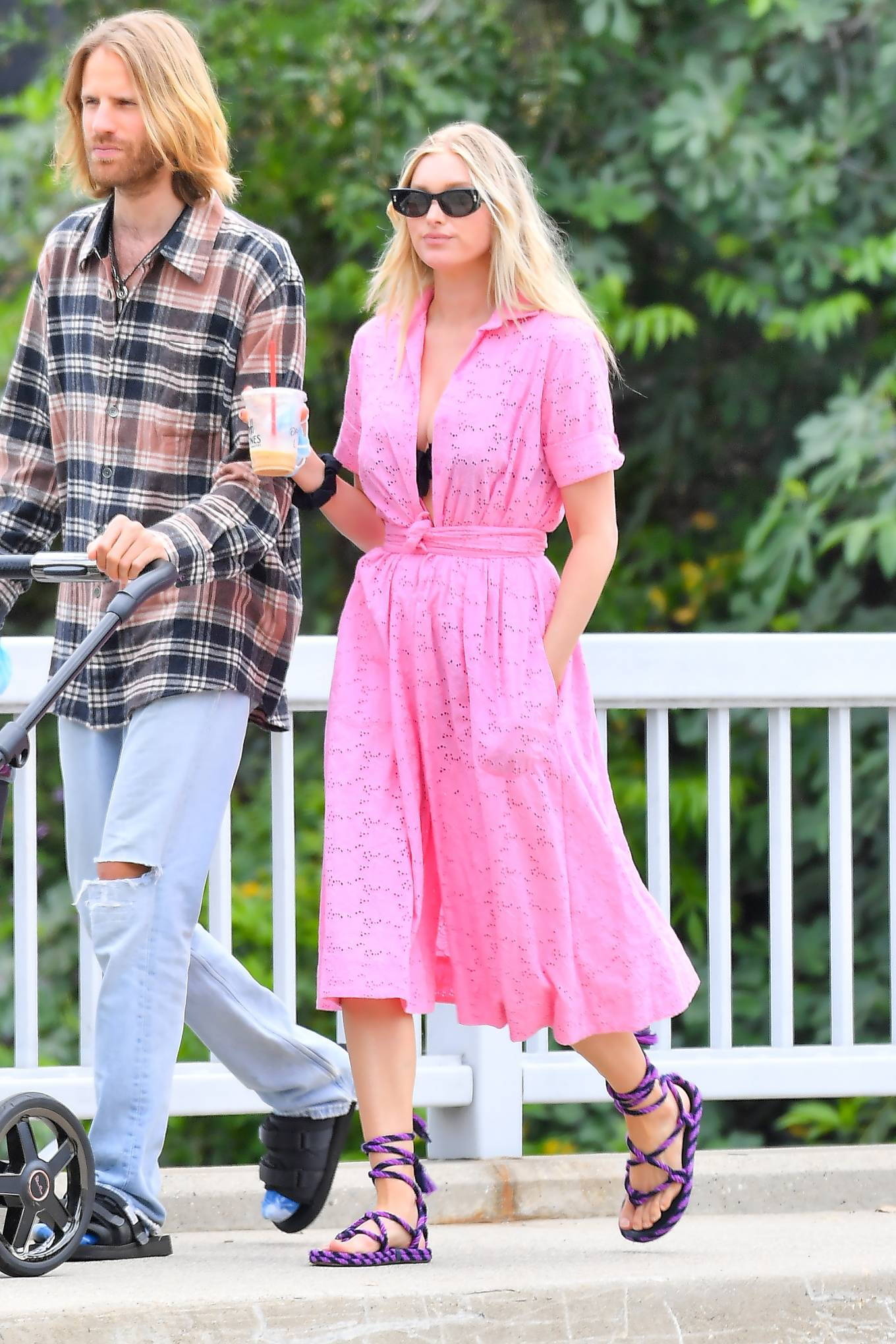 Elsa Hosk wearing a summery shirt dress with short sleeves, shirt collar and side pockets