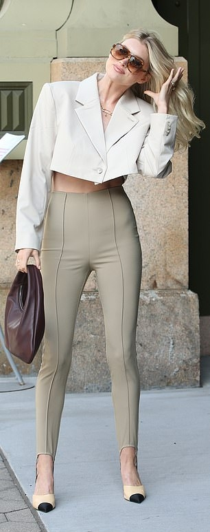 Elsa Hosk wearing pointed beige open toe sandals with high heel