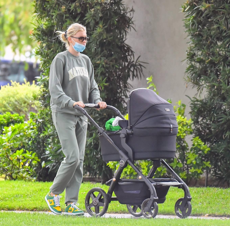 Elsa Hosk donning baggy green drawstring joggers with elastic hem