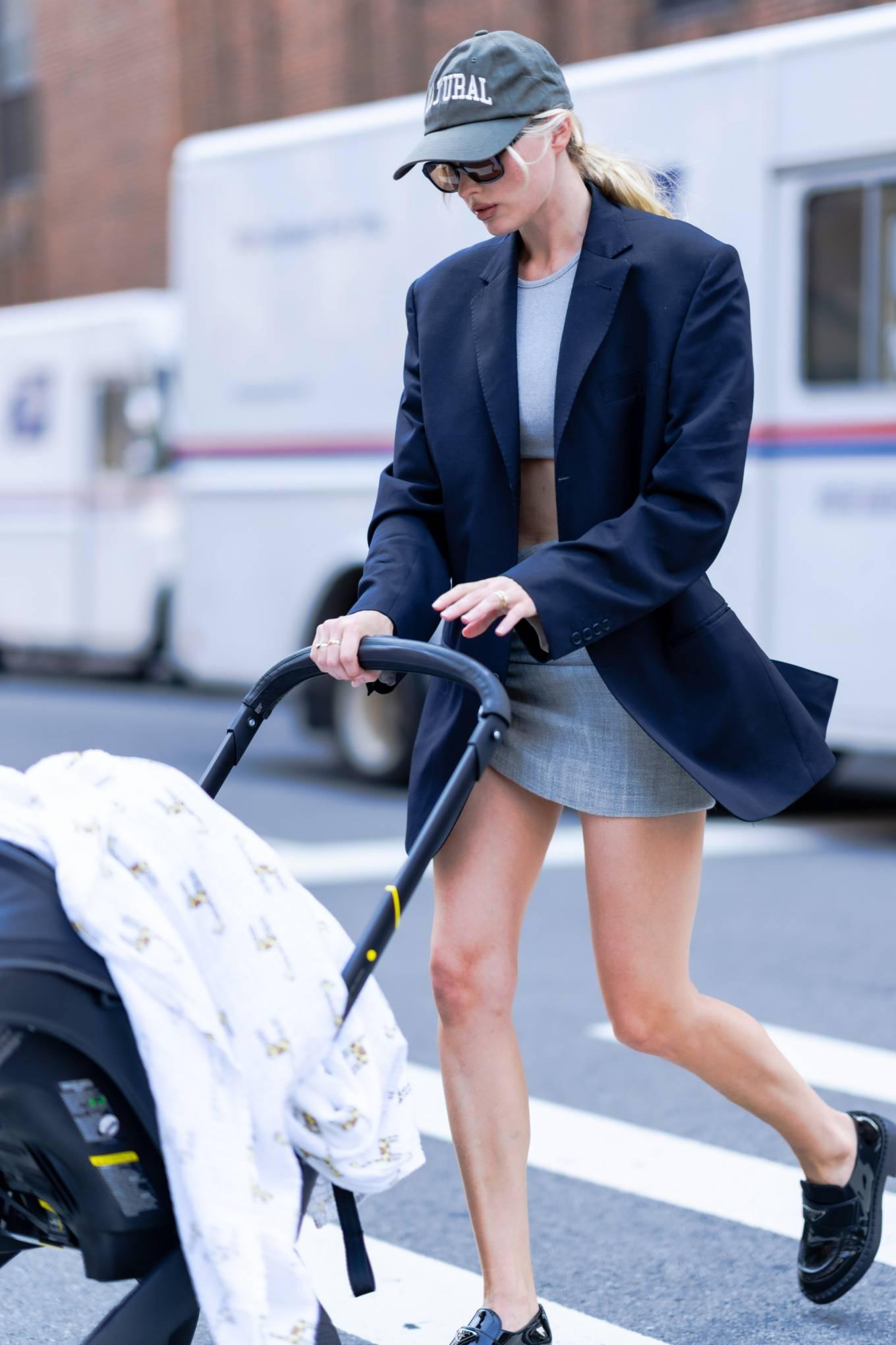 Elsa Hosk rocking a grey fitted cotton mini skirt