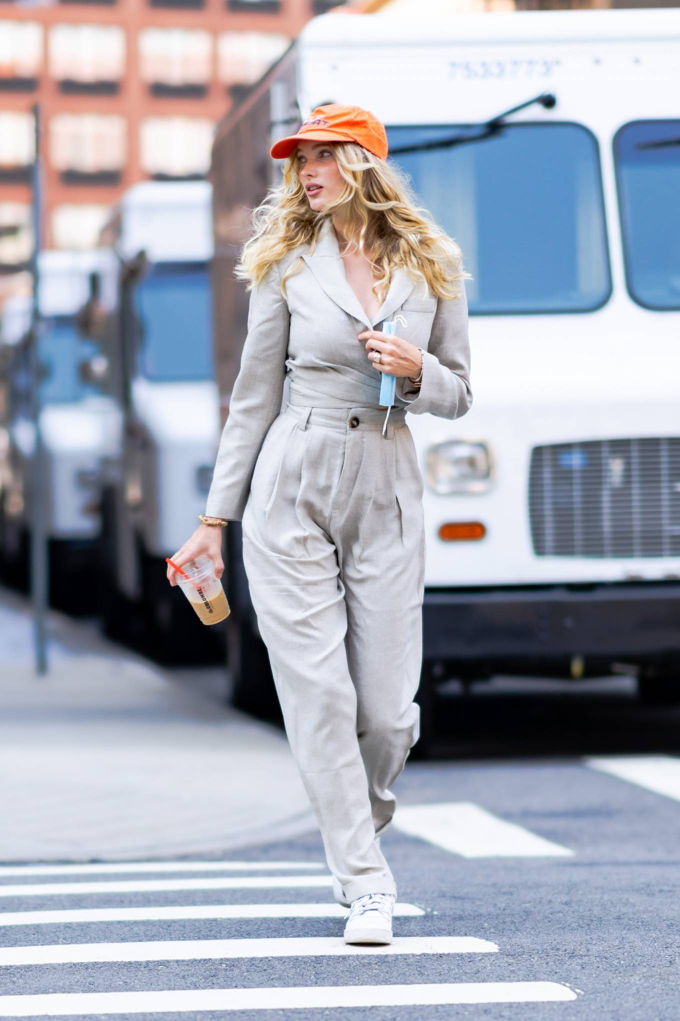 Elsa Hosk wearing round white lace-up sneakers