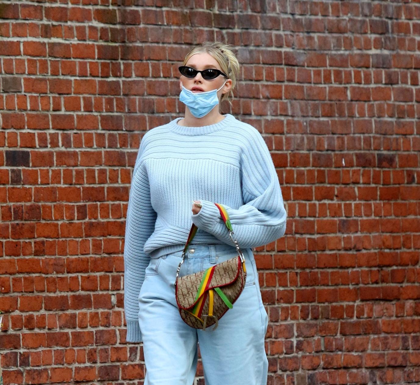 Elsa Hosk rocking straight fit light blue denim high rise jeans