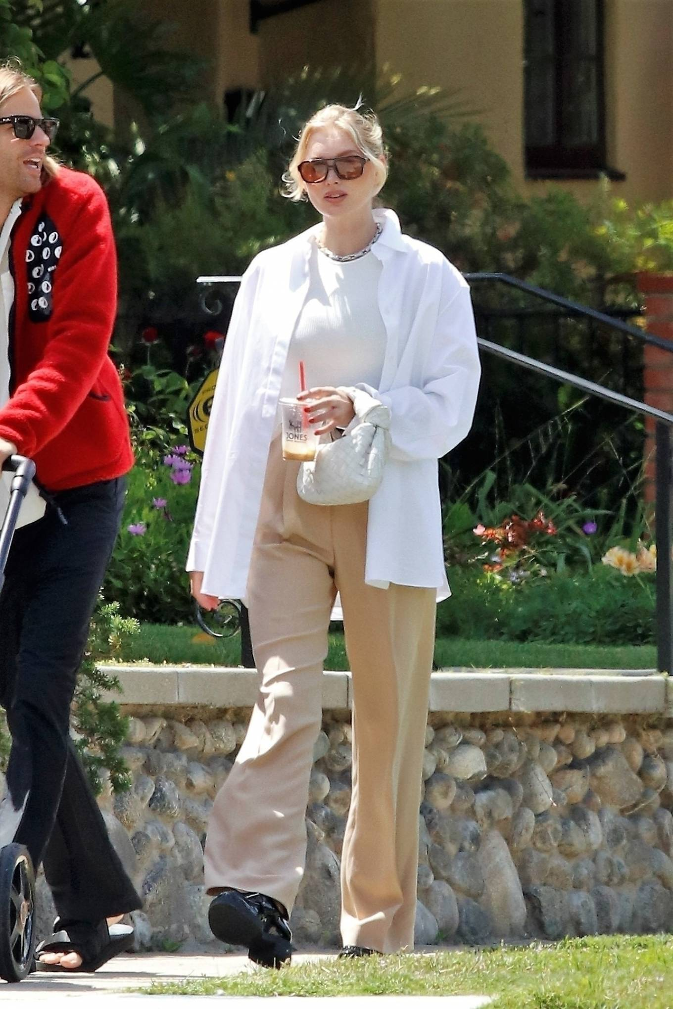 Elsa Hosk rocking a relaxed fit white open front overcoat with full sleeves and point collar