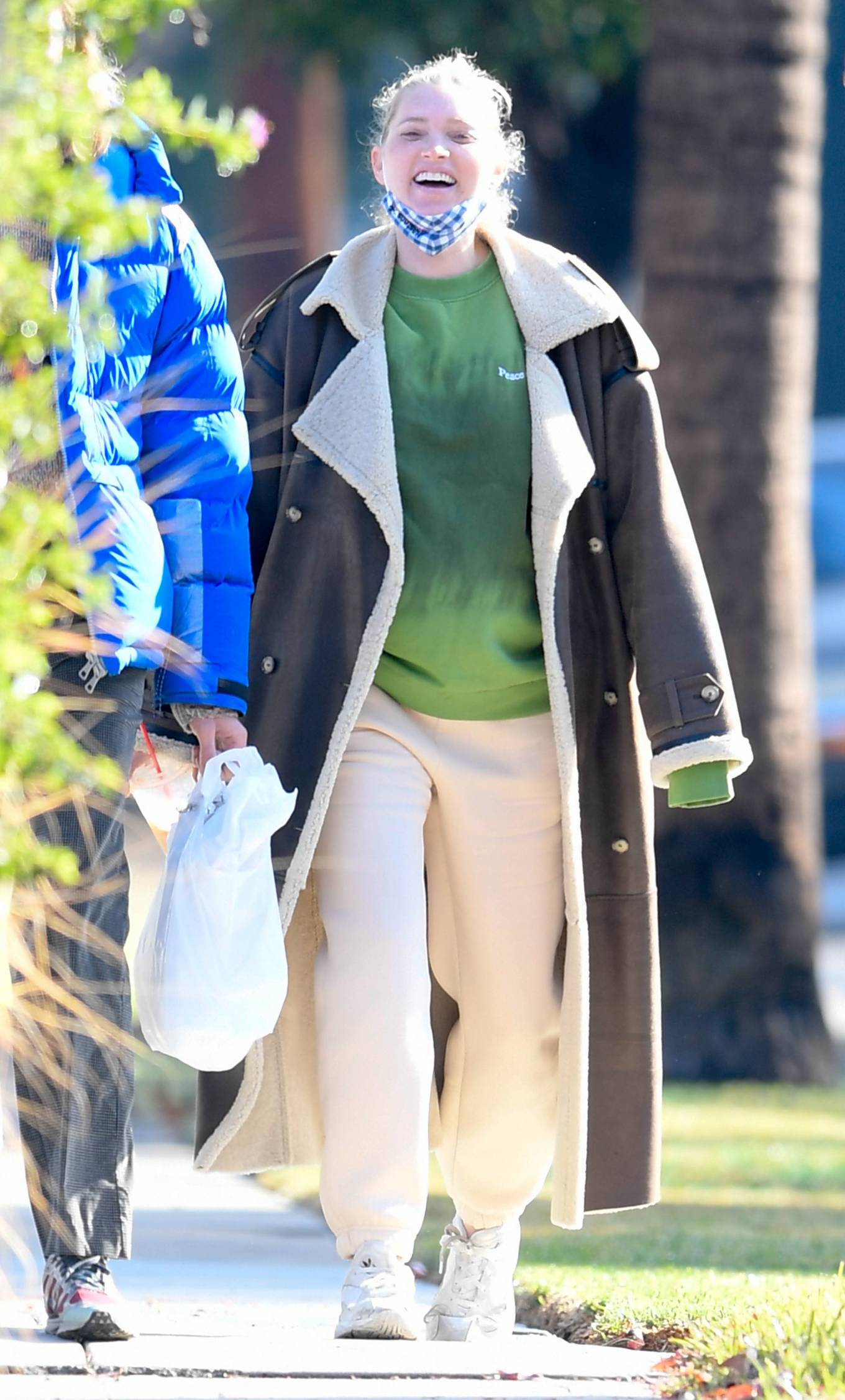 Elsa Hosk rocking round white Adidas lace-up sneakers with chunky heel