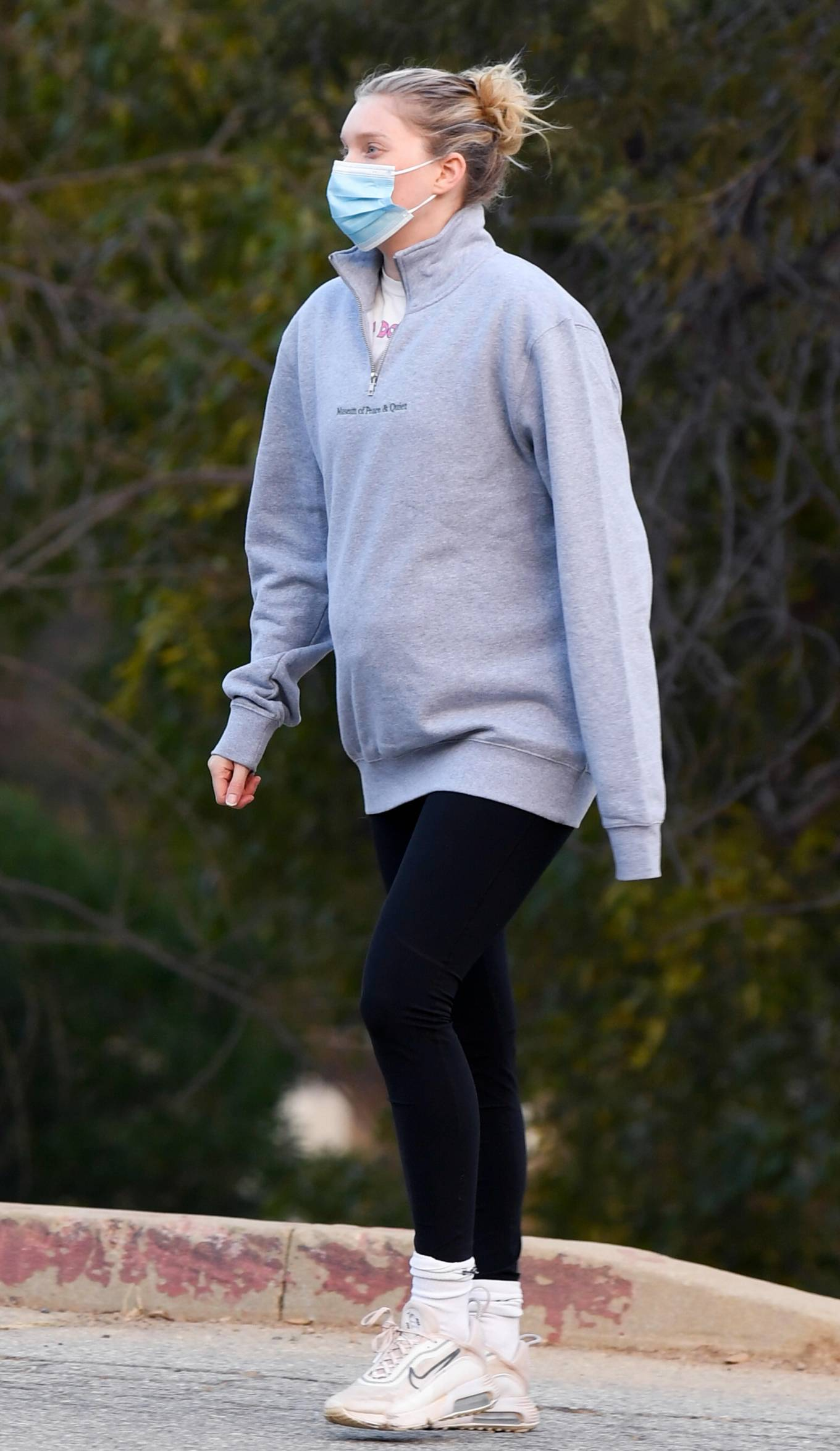 Elsa Hosk donning a relaxed fit grey caption print cotton sweatshirt with full sleeves, ribbed cuffs, zipper accents, a mock neck and ribbed hem