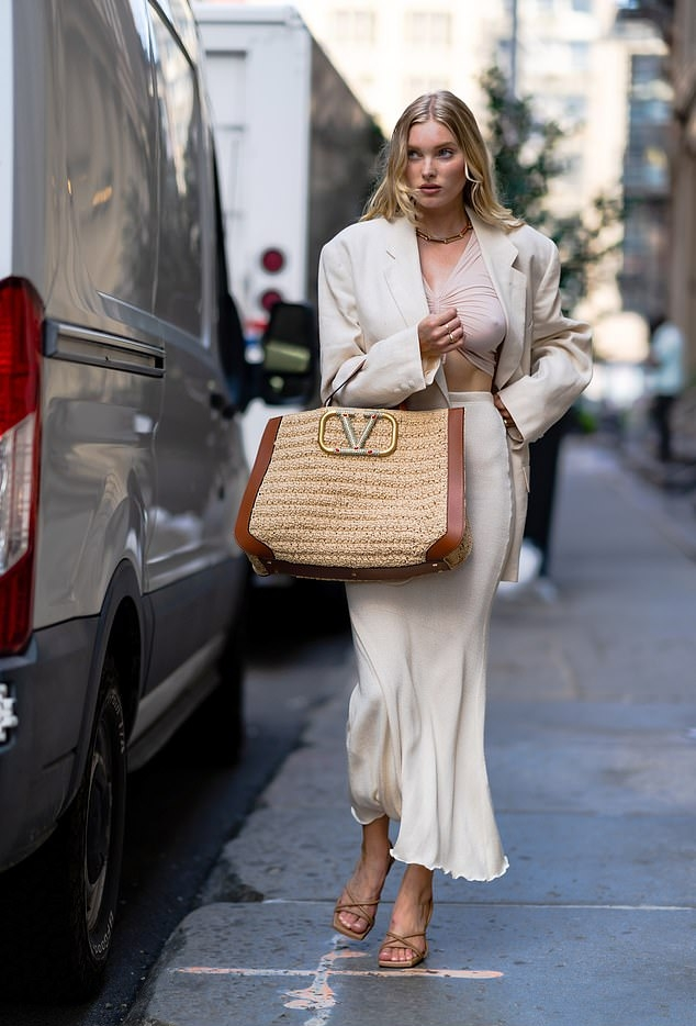 Elsa Hosk wearing a vintage cream blazer with full sleeves and lapel collar