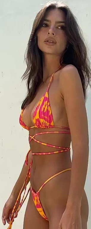 Emily Ratajkowski wearing a plunging bi color bikini top with tie back, a halter neck and two ties at the shoulder