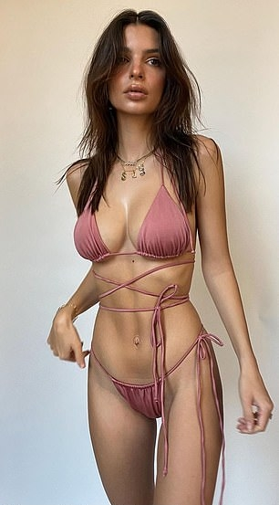 Emily Ratajkowski donning a nude pink nylon bikini top with tie back and ruched