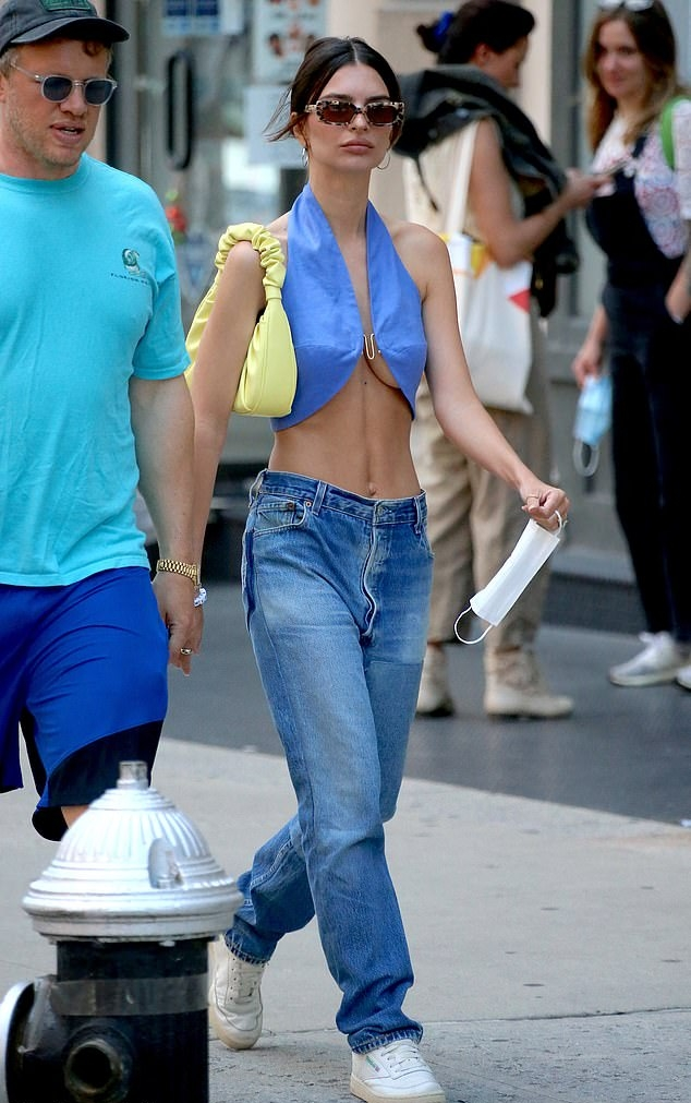Emily Ratajkowski wearing a revealing light blue top with a halter neck
