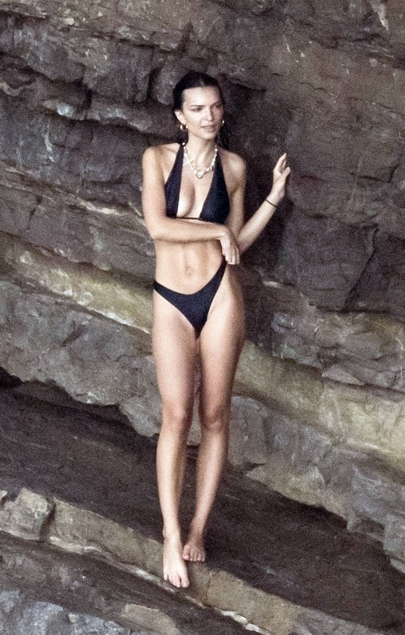 Emily Ratajkowski rocking a skimpy black bikini top with tie back, a halter neck and two ties at the shoulder