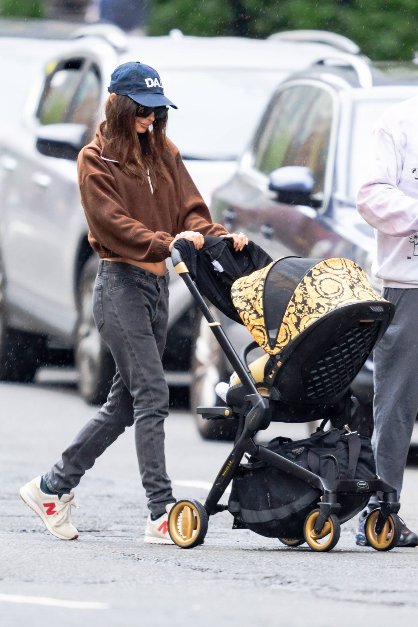 Emily Ratajkowski rocking white red lace-up sneakers by New Balance