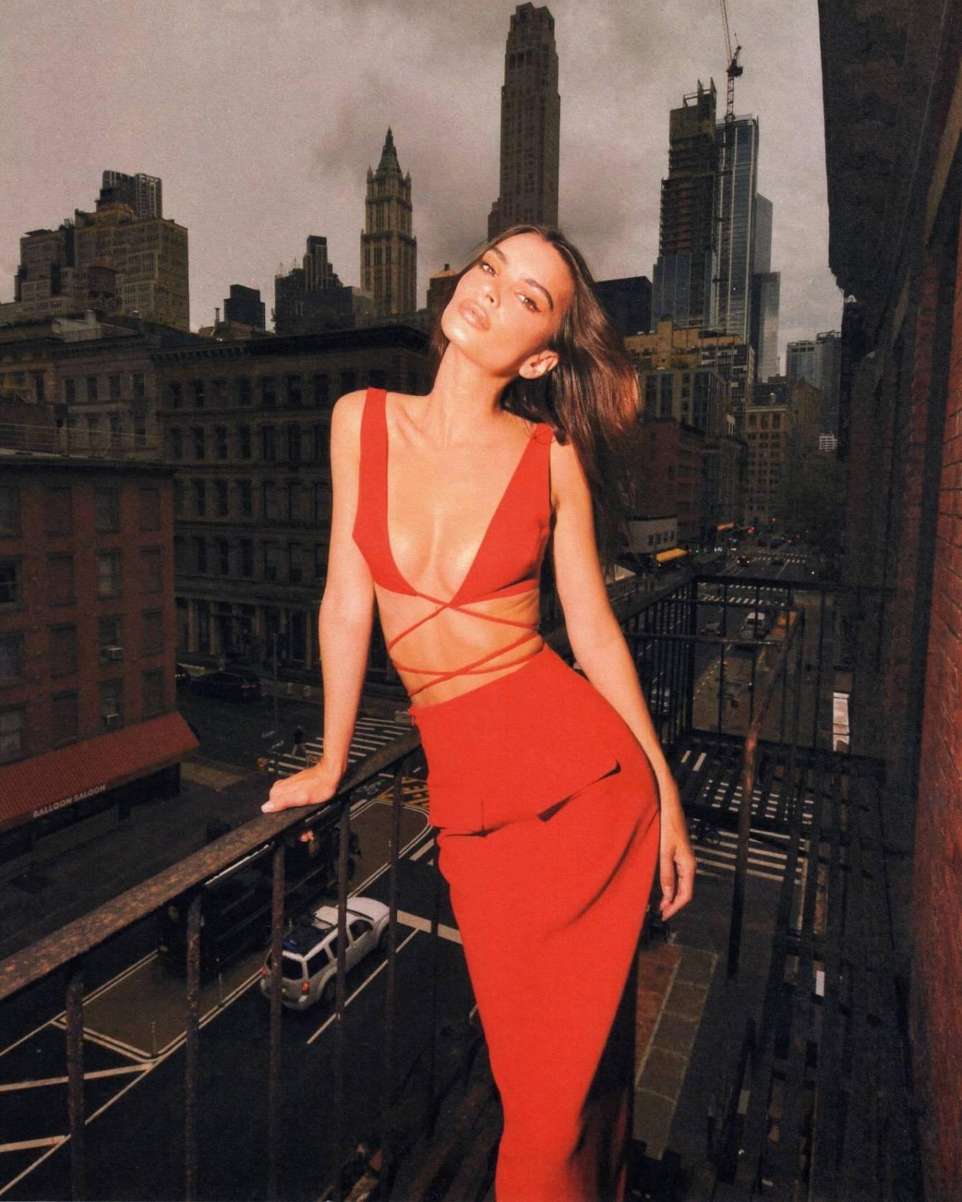 Emily Ratajkowski donning a red figure hugging matchstick skirt