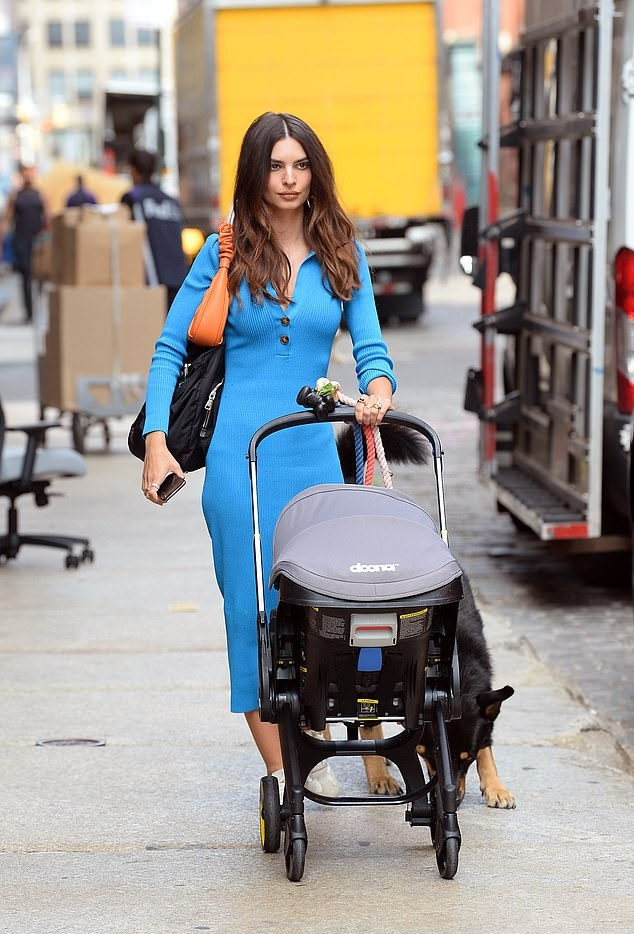 Emily Ratajkowski donning a figure hugging blue dress while out and about in New York