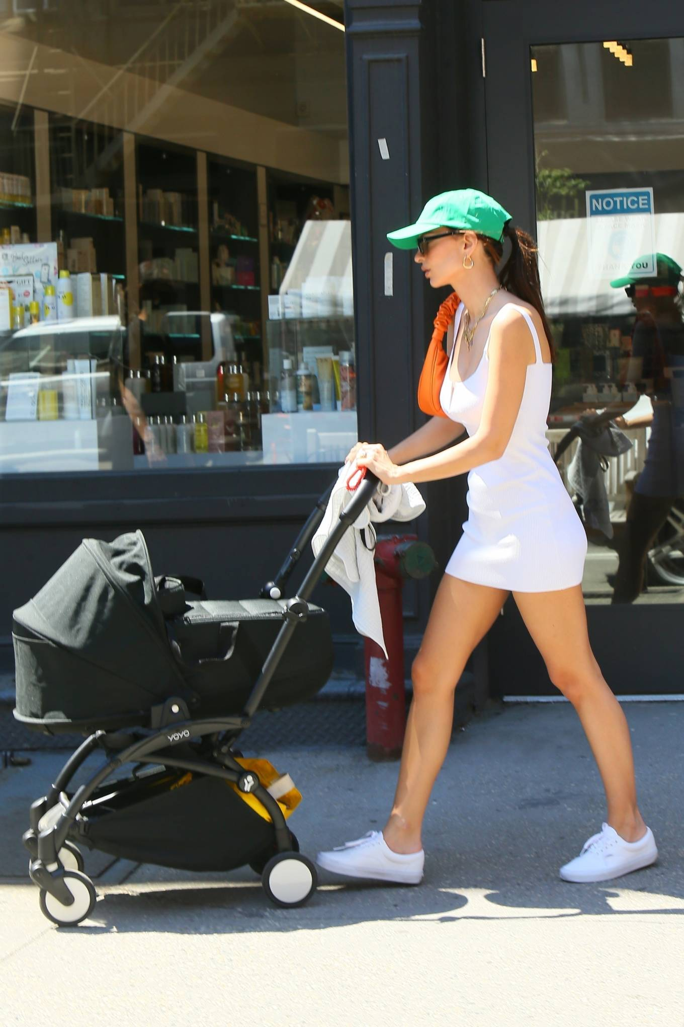 Emily Ratajkowski donning round white lace-up sneakers with flat heel