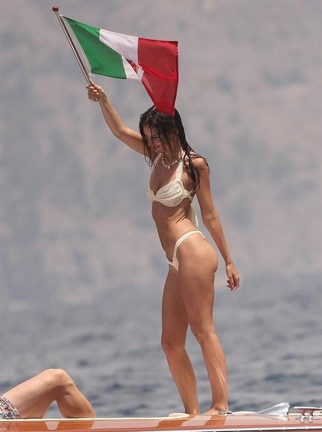 Emily Ratajkowski wearing skimpy off white low rise bikini bottom