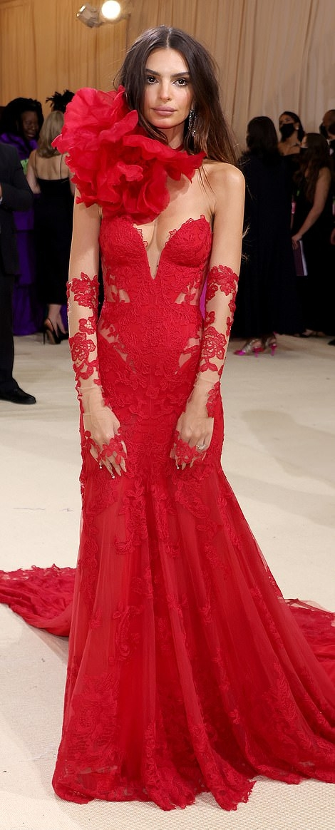 Emily Ratajkowski donning a plunging neck red gown with floral print