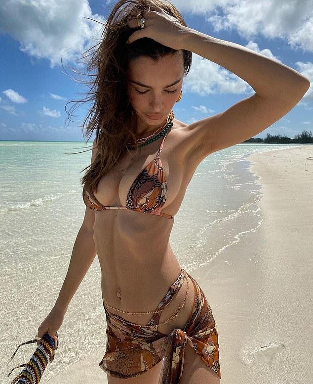 Emily Ratajkowski rocking skimpy printed bikini bottom with low rise