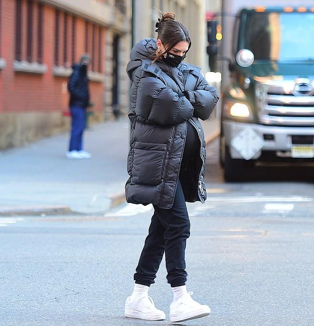 Emily Ratajkowski donning relaxed fit black drawstring ankle length joggers with elastic hem