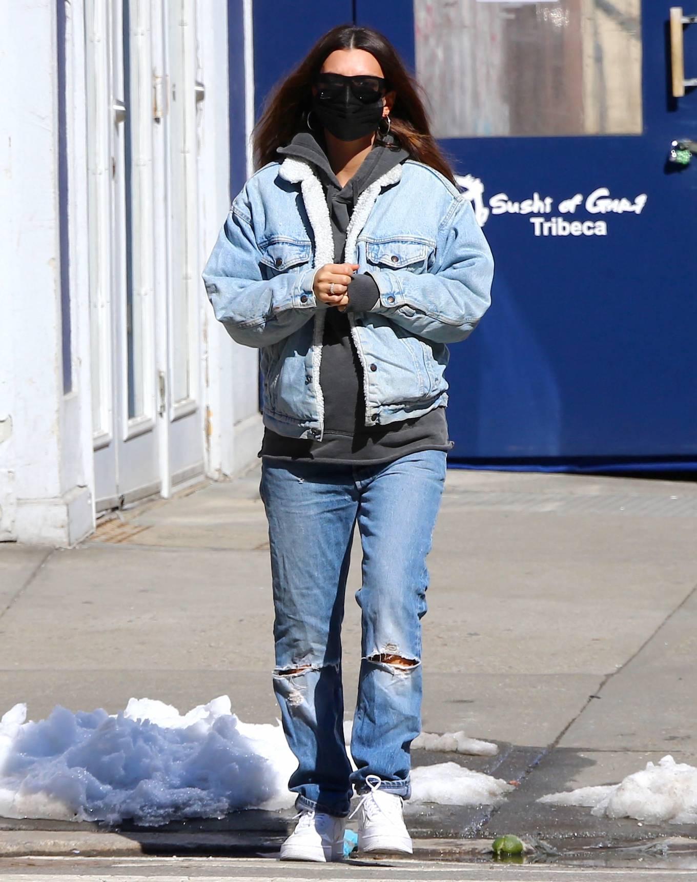Emily Ratajkowski wearing round white Nike lace-up sneakers with flat heel