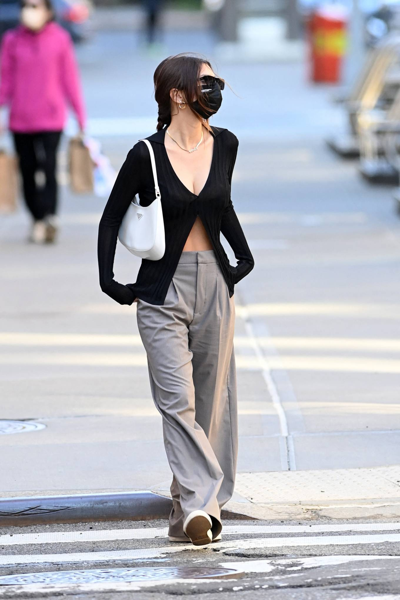 Emily Ratajkowski, black  sneakers, Keds  sneakers, black Aya Muse cardigan, white Prada shoulder bag, round, lace-up, flat heel, canvas, grey trousers, black sunglasses