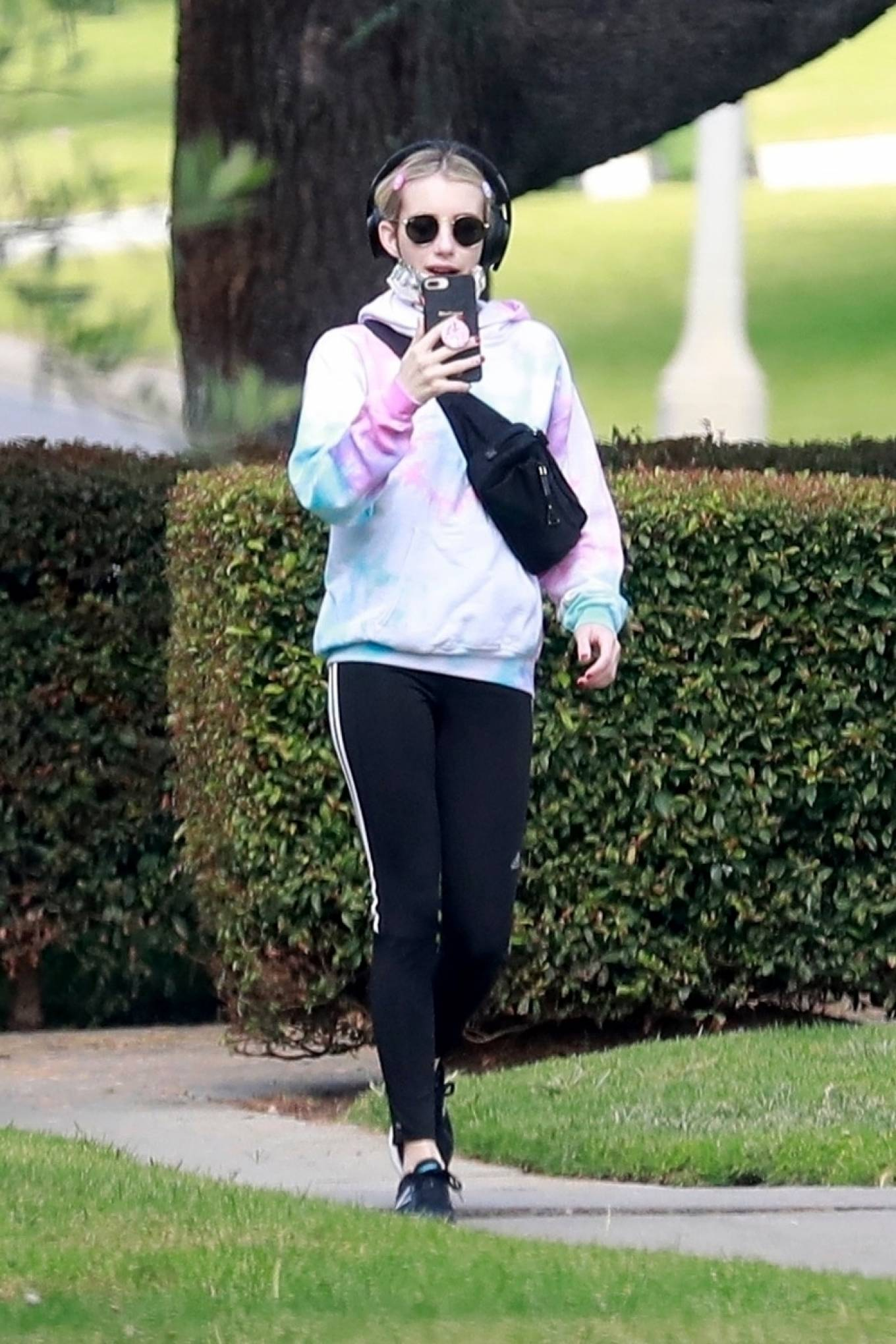 Emma Roberts rocking black mesh lace-up sneakers by New Balance