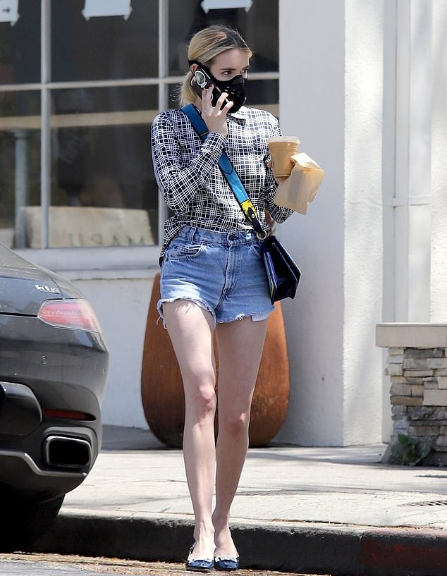 Emma Roberts donning a White black checks shirt with a cotton fabric, full sleeves, shirt collar and black checks